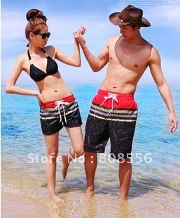 Free Shipping the price of two Flame pattern  couple beach pants women/men shorts of beach style trousers in stock